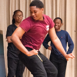 Male student dancing at One World Middle School performance