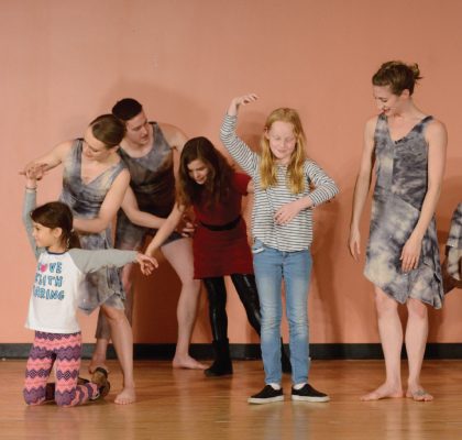 Amanda Selwyn Dance Theatre artists dancing in a community workshop at East Village Community School, NYC
