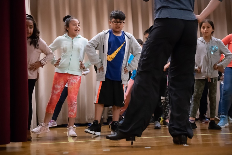 students doing exercises in tap dance class
