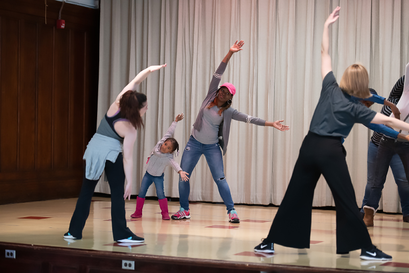 students and parents stretching in dance class