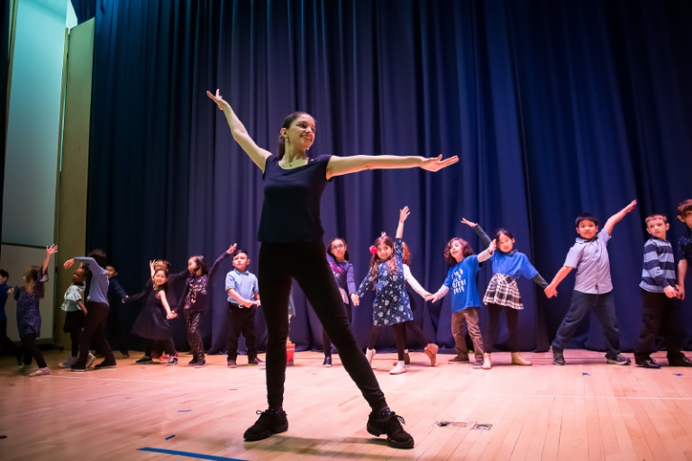students mirroring their teacher in dance class